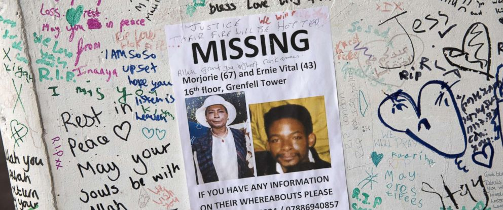 PHOTO: Missing person signs are hung around the site of Grenfell Tower, July 12, 2017, in London.