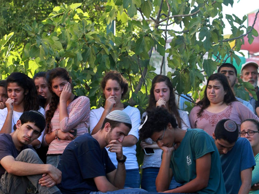 PHOTO: Friends and relatives of Israeli Hallel Yaffa Ariel, a 13-year-old girl who was fatally stabbed by a Palestinian attacker in her home, mourn during her funeral in Kiryat Arba, outside the West Bank city of Hebron on June 30, 2016.