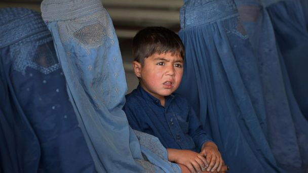 PHOTO: Afghan refugee families wait to be registered at the United Nations High Commissioner for Refugees (UNHCR) repatriation center on the outskirts of Peshawar, April 27, 2017.