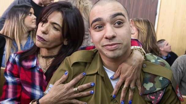 PHOTO: Israeli soldier Elor Azaria (R), who shot dead a wounded Palestinian assailant in March 2016, is embraced by his mother Oshra (L) at the start of his sentencing hearing in a military court in Tel Aviv, Feb. 21, 2017.