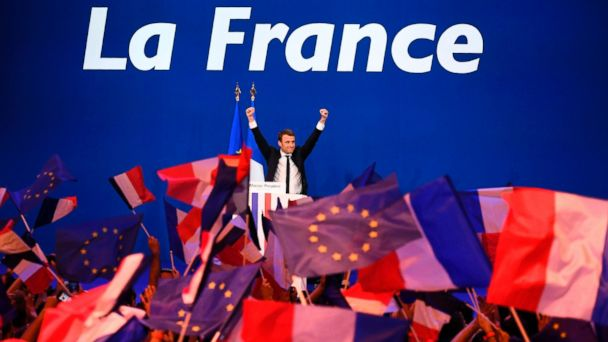 PHOTO: French presidential election candidate for the En Marche ! movement Emmanuel Macron waves at the audience during a meeting at the Parc des Expositions in Paris, April 23, 2017, after the first round of the Presidential election.