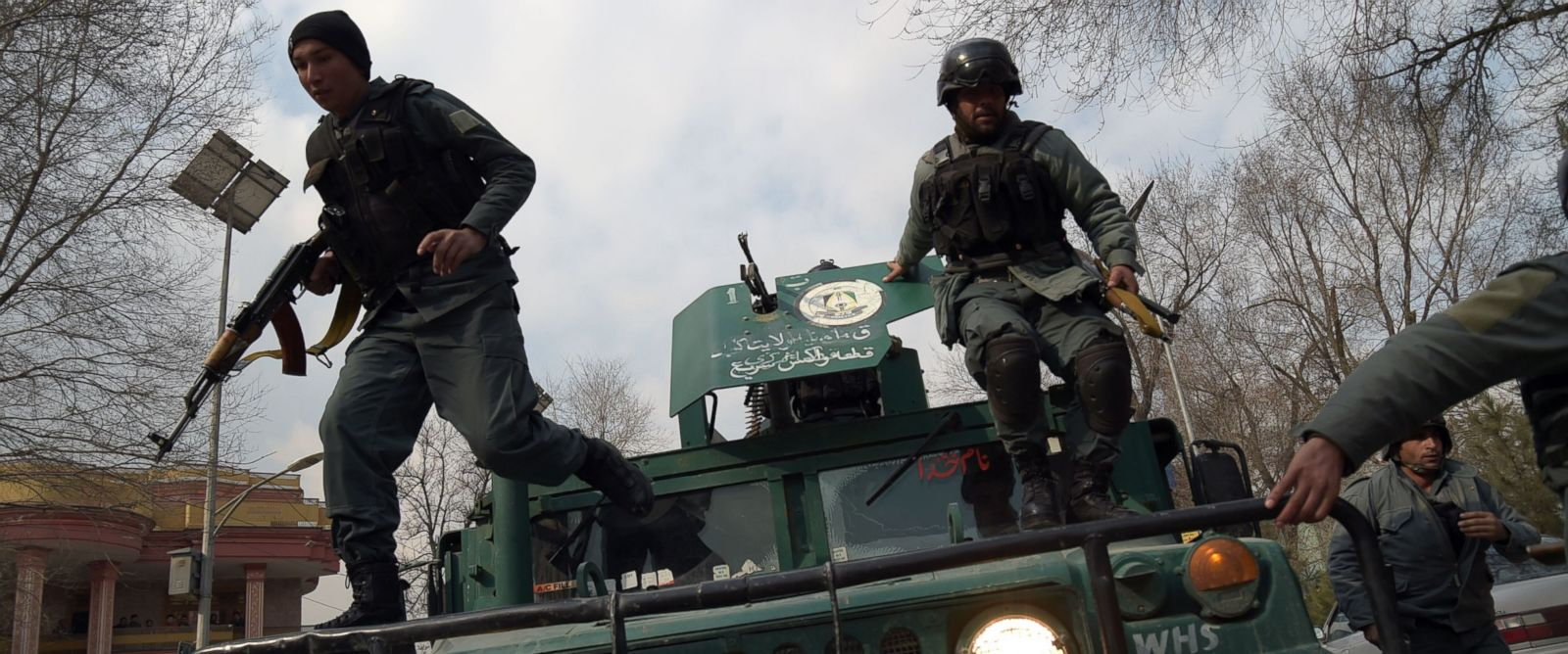 PHOTO: Afghan policemen leap from a vehicle as they arrive at the site of an explosion in Kabul, March 8, 2017.