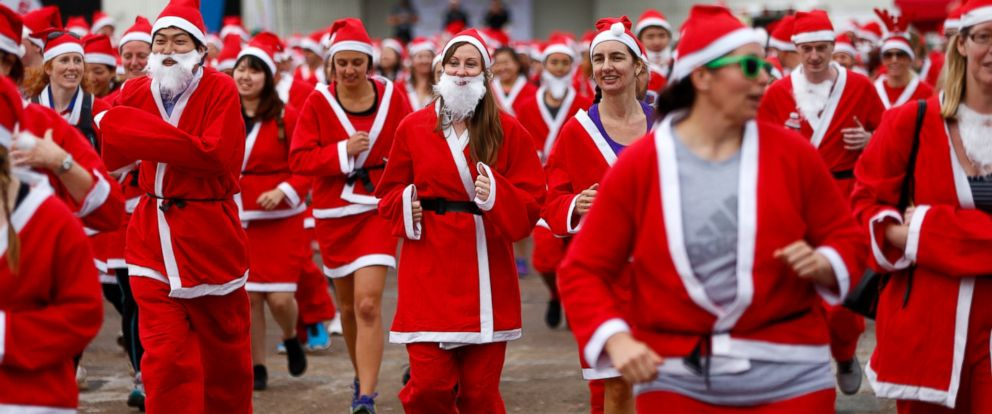 PHOTO: People dressed as Santa run around Queens Wharf during the annual KidsCan Santa Fun Run on Dec. 2, 2015 in Auckland, New Zealand.