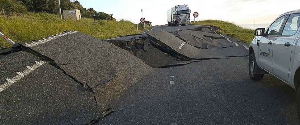 PHOTO: Cars and trucks are halted due to earthquake damage on State Highway One near Oaro on the South Islands east coast in New Zealand.