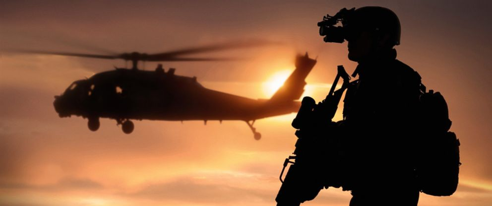PHOTO: A Navy Seal with a helicopter behind him in an undated photo.