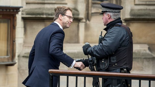 PHOTO: British Conservative Party politician Tobias Ellwood, who gave first aid to the fatally wounded police officer Keith Palmer shakes hands with an armed police officer as he arrives at the Houses of Parliament in London on March 24, 2017.