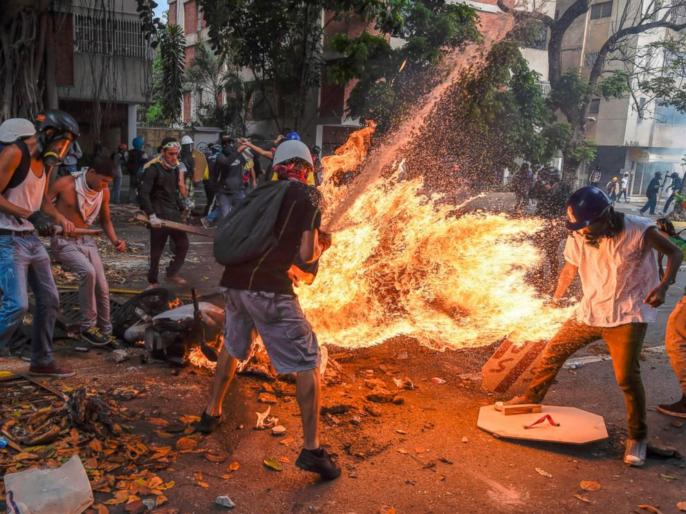 PHOTO: The gas tank of a police motorcycle explodes during clashes in a protest against Venezuelan President Nicolas Maduro, in Caracas on May 3, 2017.