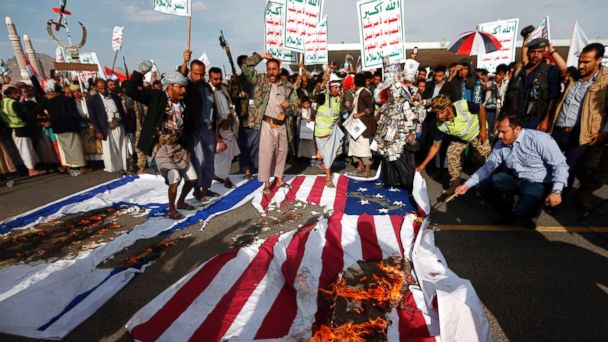 PHOTO: Yemeni supporters of the Huthi rebels burn Israeli and U.S. flags as they shout slogans against the United States during an anti-U.S. protest in Sanaa on May 20, 2017.