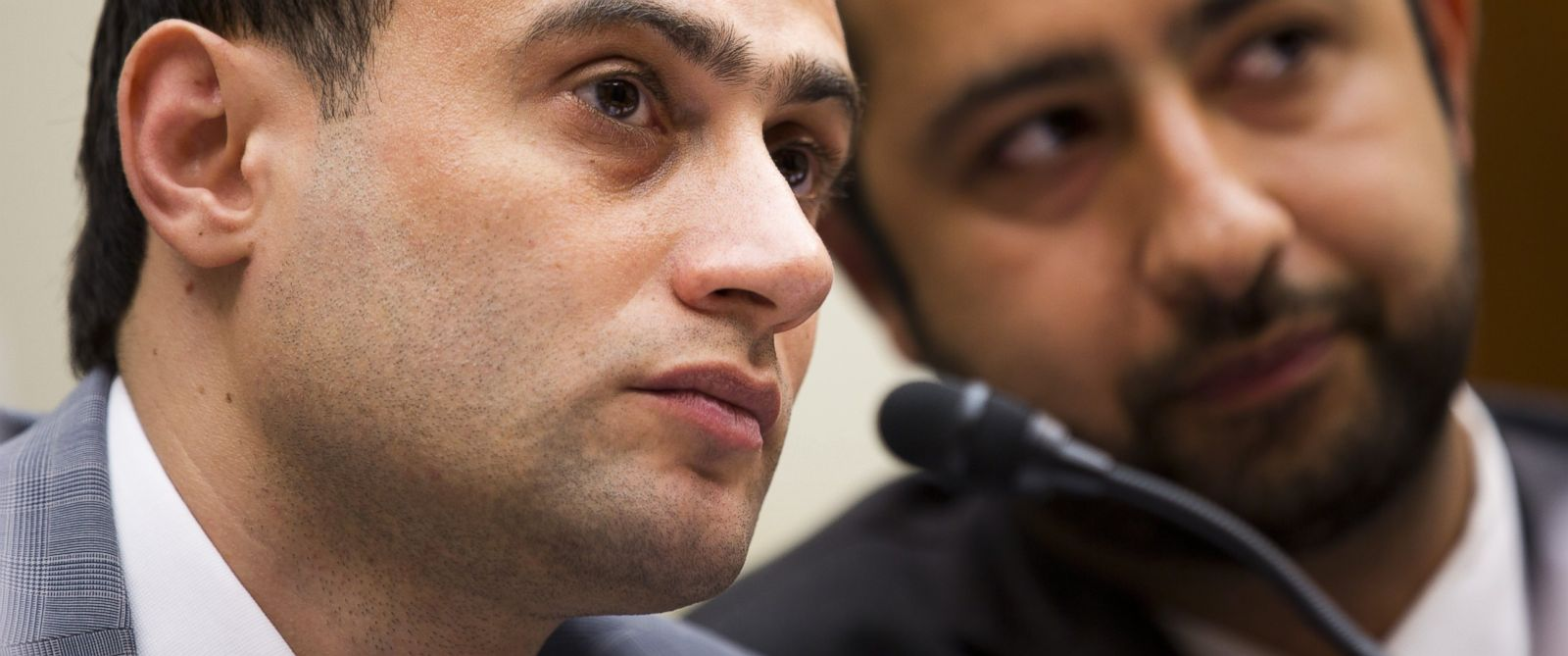 PHOTO: Dr. Mohamed Tennari listens to his translator during a hearing convened by the House Foreign Affairs Committee in Washington, June 17, 2015, to examine the use of chemical weapons in Syria by the Assad regime.