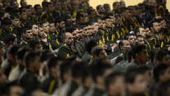 Afghan defense officers attend a security handover ceremony at a military academy outside Kabul, June 18, 2013.