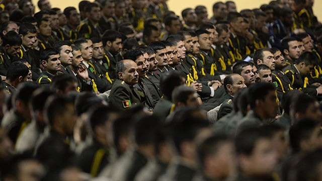 PHOTO: Afghan defense officers attend a security handover ceremony at a military academy outside Kabul, June 18, 2013.