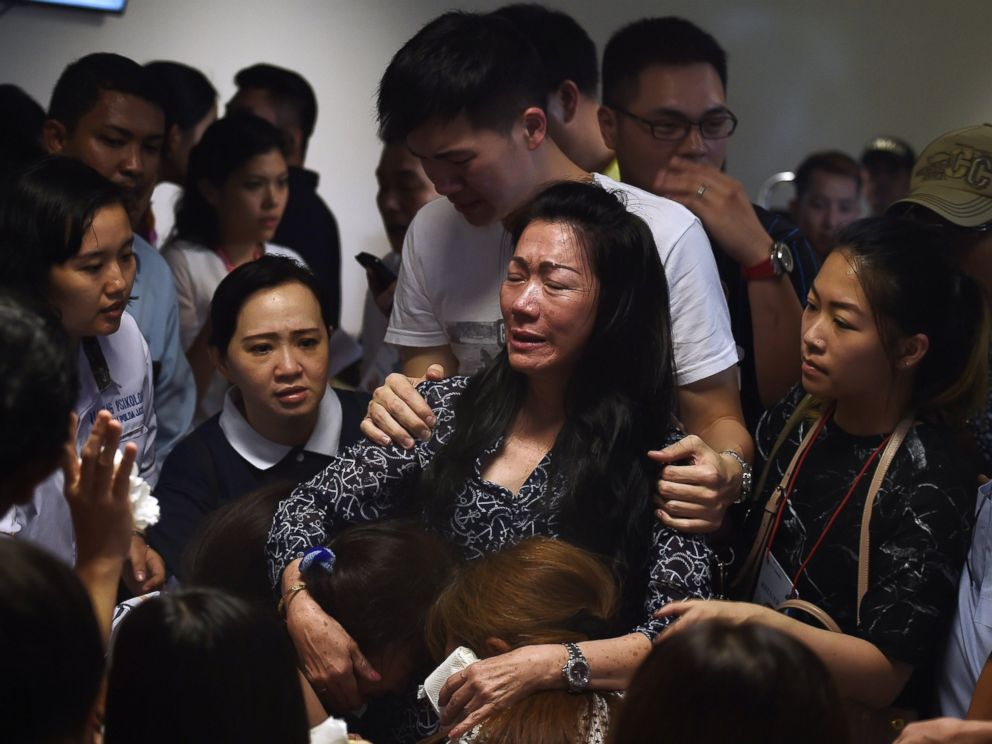 PHOTO: Family members of passengers onboard the missing air carrier AirAsia flight QZ8501 react after watching news reports inside the crisis center set up at Juanda International Airport in Surabaya on Dec. 30, 2014.