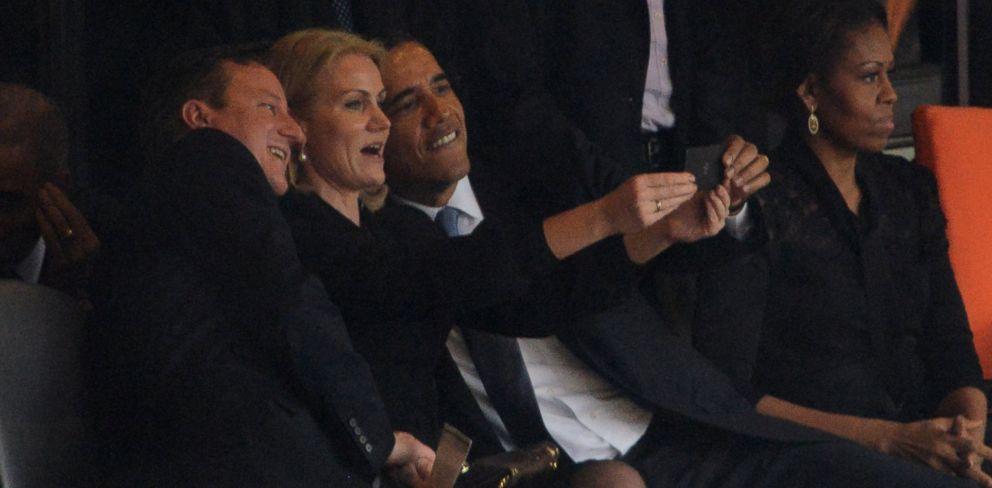 PHOTO: US President Barack Obama, right, Denmarks Prime Minister Helle Thorning Schmidt and British Prime Minister David Cameron