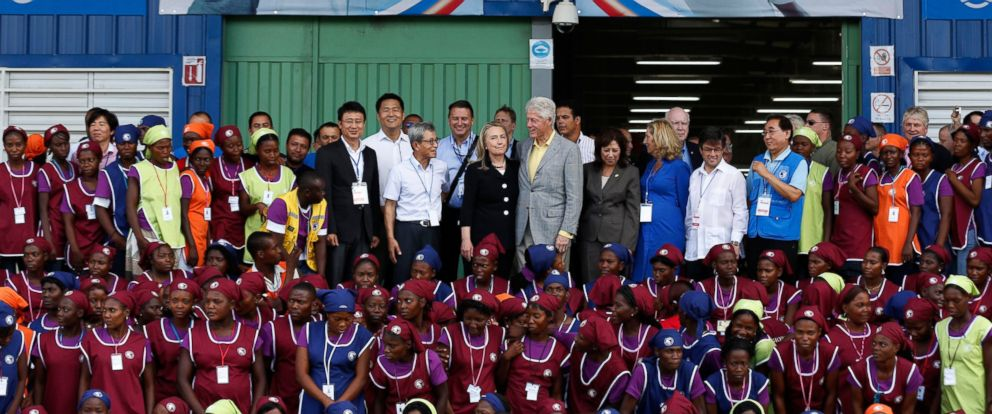 PHOTO: Hillary Clinton and Bill Clinton (center) pose with workers at the grand opening ceremony of the new Caracol Industrial Park in Caracol, Haiti, Oct. 22, 2012.
