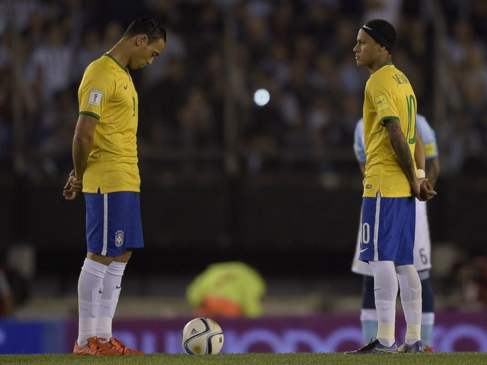 PHOTO: Brazilian football team players Ricardo Oliveira and Neymar Jr. participate in a minute of silence in honor of victims of attacks in France, before their football match against Argentina, in Buenos Aires, on Nov. 13, 2015.