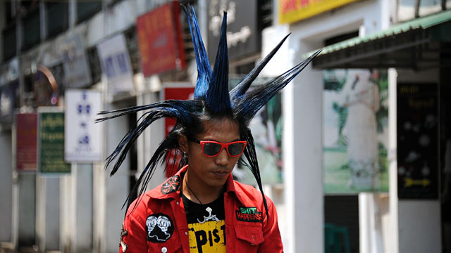 PHOTO: A punk arrives at the Bogyoke market during the first day of Thingyan in Yangon.