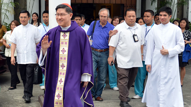 PHOTO: Roman Catholic Archbishop of Manila, Cardinal Luis Antonio Tagle, waves to photographers after a service at a church in Manila, Feb. 13, 2013.