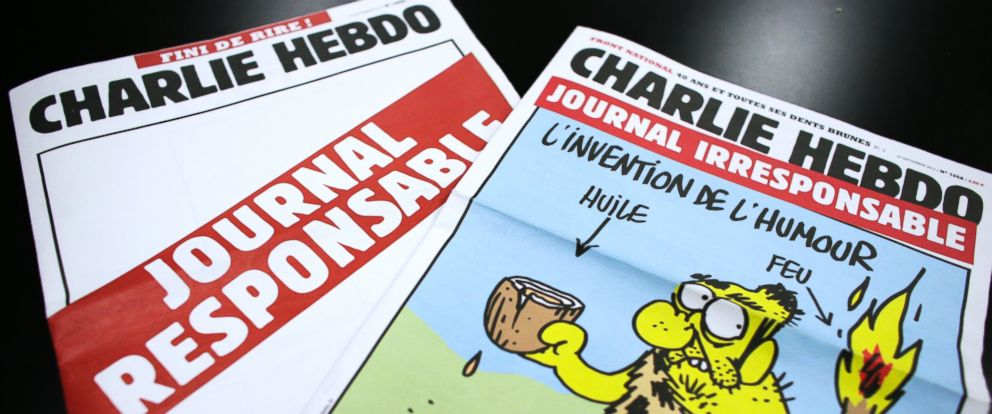 """PHOTO: A picture taken on September 25, 2012 in Paris shows two editions of French satirical magazine """"Charlie Hebdo"""" one reading """"Irresponsible newspaper,"""" right, and the other, bearing an empty front page reading """"responsible newspaper."""""""