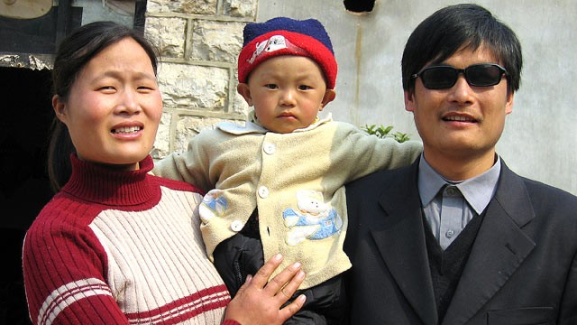 PHOTO: Chen Guangcheng, right, stands with his wife and son Chen Kerui outside their home in Dondshigu village, Shandong province, in this 2005 file photo.