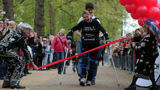 "Claire Lomas, who is paralysed and walks with the aid of a ""bionic"" suit, finishes the London Marathon on May 8, 2012, 16 days after the event began."