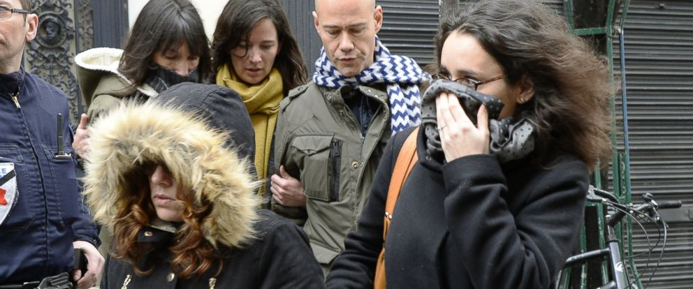 PHOTO: French cartoonist Corinne Rey, far right, whose pen name is Coco, arrives to attend a meeting gathering editorial staff of French satirical weekly newspaper Charlie Hebdo and Liberation in Paris, Jan. 9, 2015.