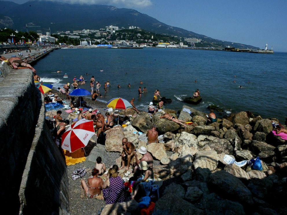 PHOTO: Sunbathers lay out on the rugged beach of Yalta in this August 18, 2003 file photo taken in Crimea.