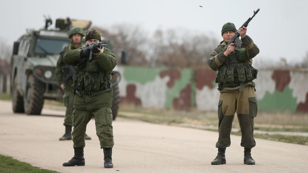 PHOTO: Troops under Russian command fire weapons into the air