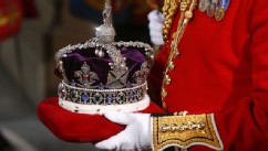 PHOTO: The Imperial State Crown, worn by Queen Elizabeth II during her speech for the State Opening of Parliament, is carried from the Houses of Parliament in London, England.