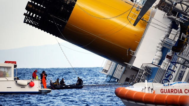 PHOTO: Boats patrol near the Costa Concordia, Jan. 15, 2012, after the cruise ship ran aground, off the coast of Tuscany, Italy.