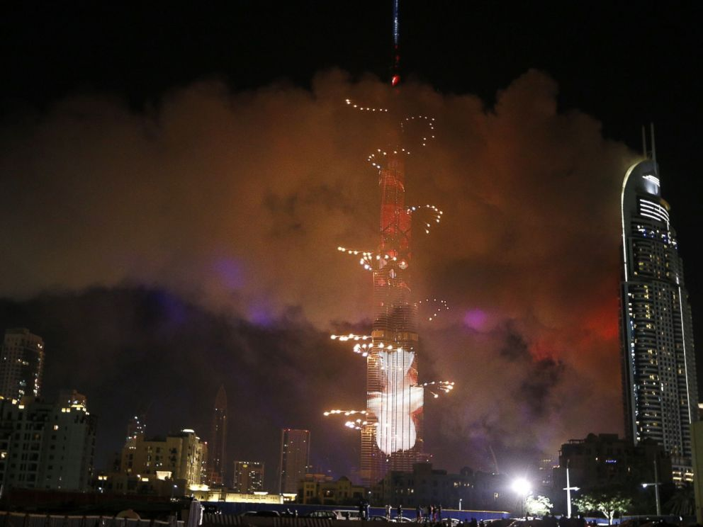 PHOTO: Smoke billows from a fire at the Address Downtown Hotel during a fireworks display at the Burj Khalifa, Jan. 1, 2016 in Dubai.