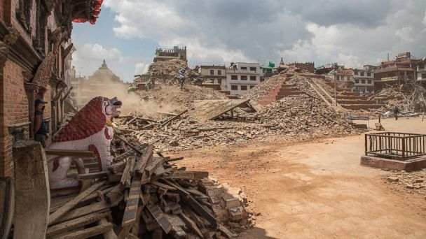 Volunteers and emergency workers search for bodies buried under the debris of the temples at Basantapur Durbar Square on April 27, 2015 in Kathmandu, Nepal.
