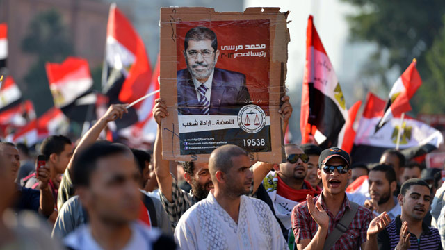 PHOTO: Egyptians celebrate at Cairos Tahrir Square the victory of Mohamed Morsi (poster) in the presidential elections on June 24, 2012.