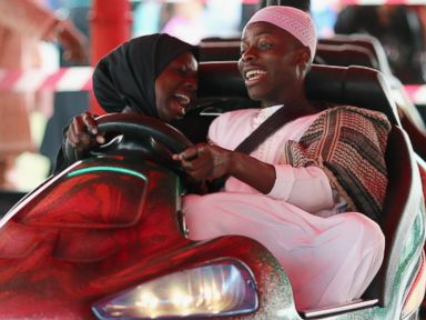 PHOTO: People ride on Bumper cars during an Eid al-Fitr celebrations in Burgess Park, July 28, 2014 in London, England.