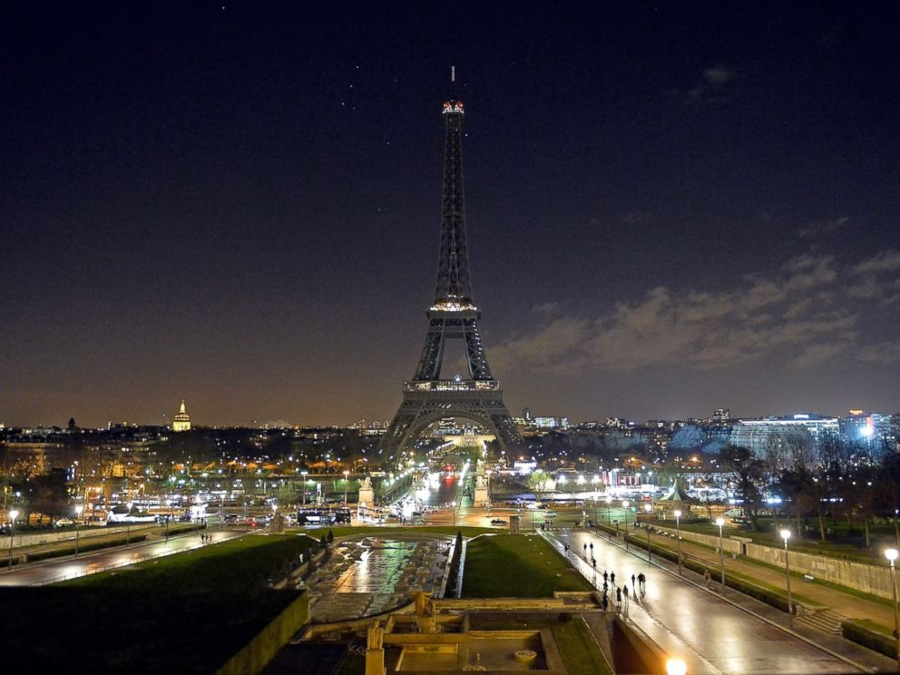 PHOTO: As a tribute for the victims of yesterdays terrorist attack, the lights of the Eiffel Tower were turned off for five minutes at 8pm local time, Jan. 8, 2015 in Paris, France.
