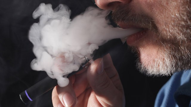 PHOTO: The owner of a shop that sells electronic cigarettes demonstrates how to use one on March 1, 2012 in Berlin, Germany.
