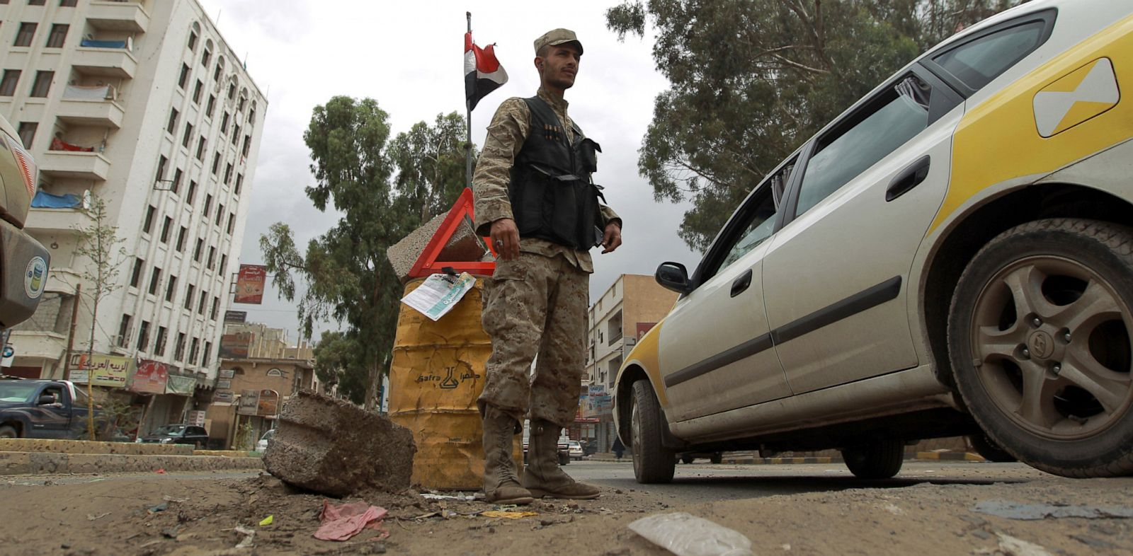 PHOTO: A Yemeni policeman stands at a check point in the capital Saana on August 3, 2013.