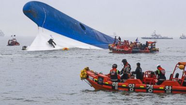 PHOTO: In this handout provided by Donga Daily, The Republic of Korea Coast Guard work at the site of ferry sinking accident off the coast of Jindo Island  on April 16, 2014 in Jindo-gun, South Korea.