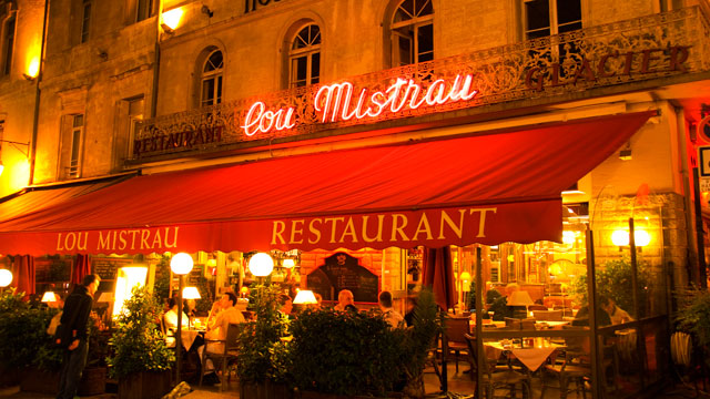 PHOTO: Lou Mistrau restaurant illuminated at night on Place de lHorloge, Avignon