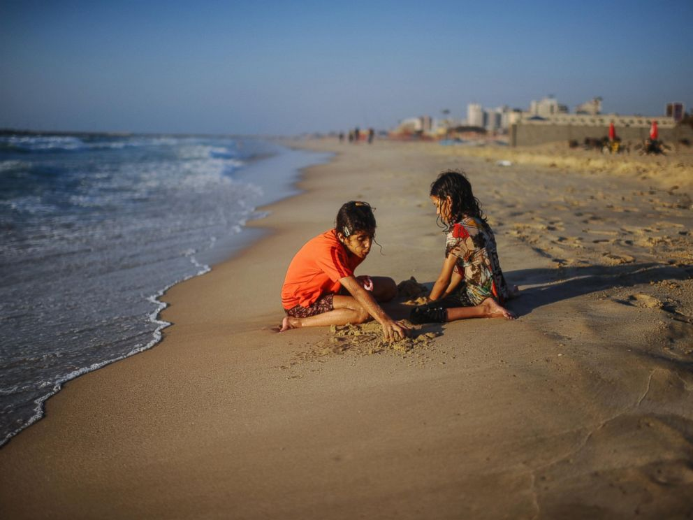 PHOTO: Palestinian children spend their time on the beaches during 72-hour humanitarian ceasefire in Gaza city, Gaza, Aug. 5, 2014.