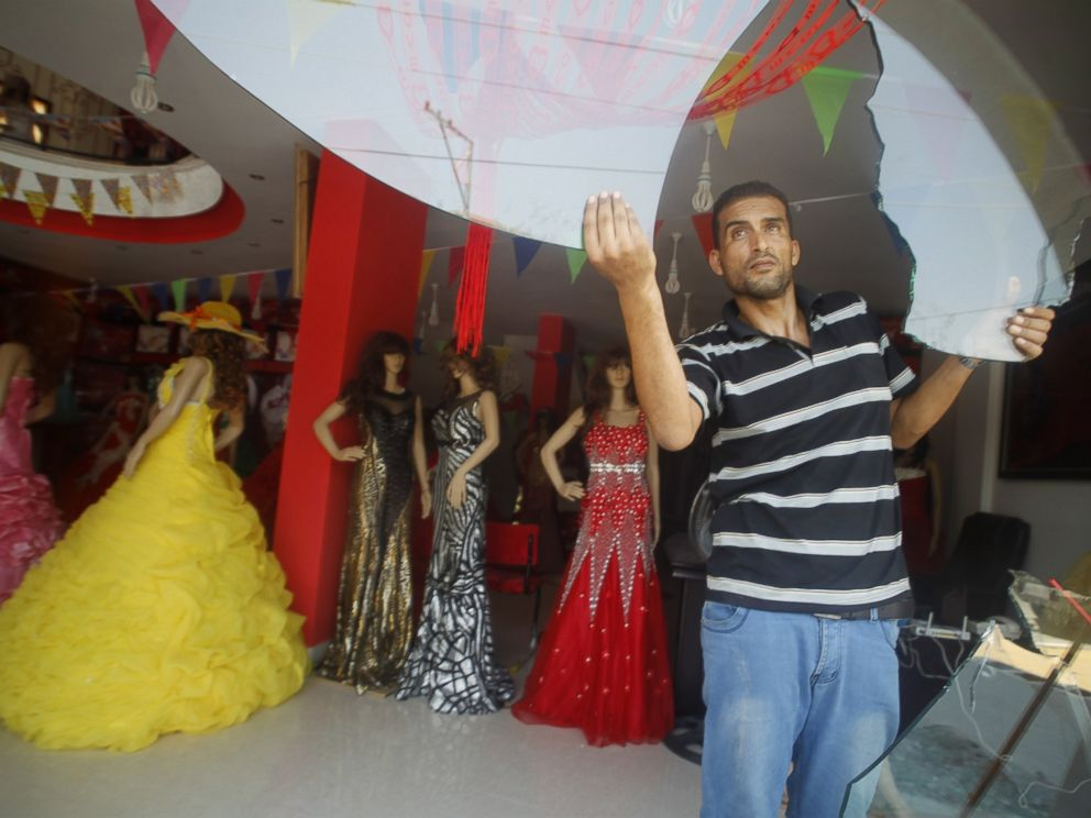 PHOTO: A Palestinian man removes the broken glass from his damaged shop which sells womens clothing, in Rafah town, in the southern Gaza Strip, on Aug. 5, 2014, as a 72-hour truce agreed by Israel and the ruling Hamas movement went into effect.