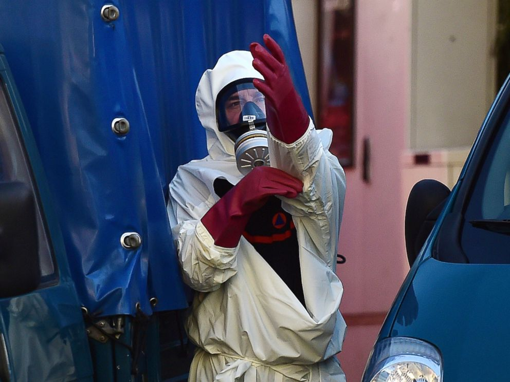 PHOTO: A decontamination unit worker suits up in front of Brussels Great Mosque in Brussels on Nov. 26, 2015.