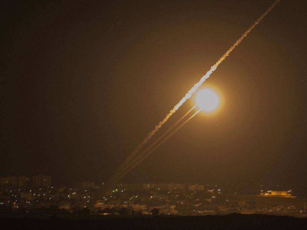 PHOTO: A picture taken from the southern Israeli Gaza border shows rockets being fired from the Gaza strip into Israel, on July 12, 2014.