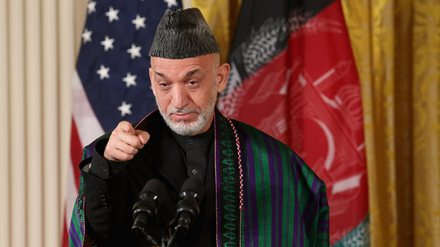 PHOTO: Afghan President Hamid Karzai speaks during a joint news conference with U.S. President Barack Obama in the East Room of the White House Jan. 11, 2013 in Washington, DC.