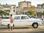 PHOTO: A driver waits for passengers in his old American car in Havana, Jan. 20, 2015.