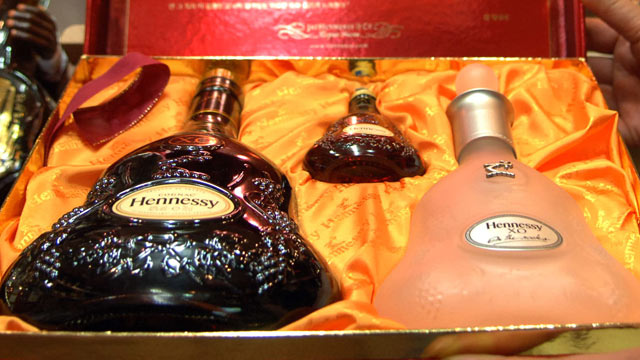 PHOTO: A liquor store owner shows displayed Hennessy cognac bottles in Seoul Korea, in this 2006 file photo. The United Nations is hitting Kim Jong Il where it hurts, cutting off trade in the luxury goods favored by the North Korean dictator and his entou
