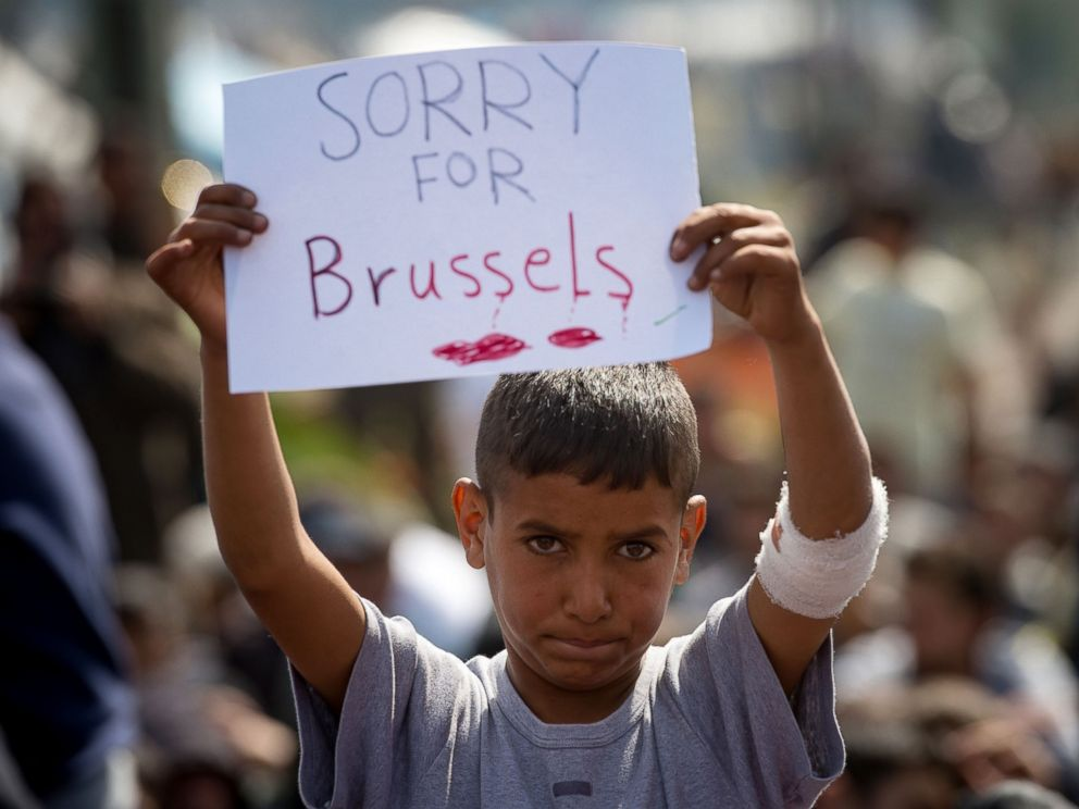 PHOTO: A boy holds a placard expressing sympathy for the victims of the terror attacks in Brussels during a protest at a makeshift camp at the Greek-Macedonian border near the village of Idomeni on March 22, 2016.