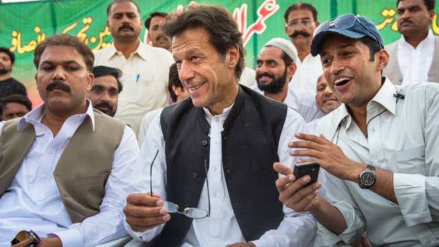 PHOTO: Imran Khan, center, smiles as he addresses supporters during an election campaign