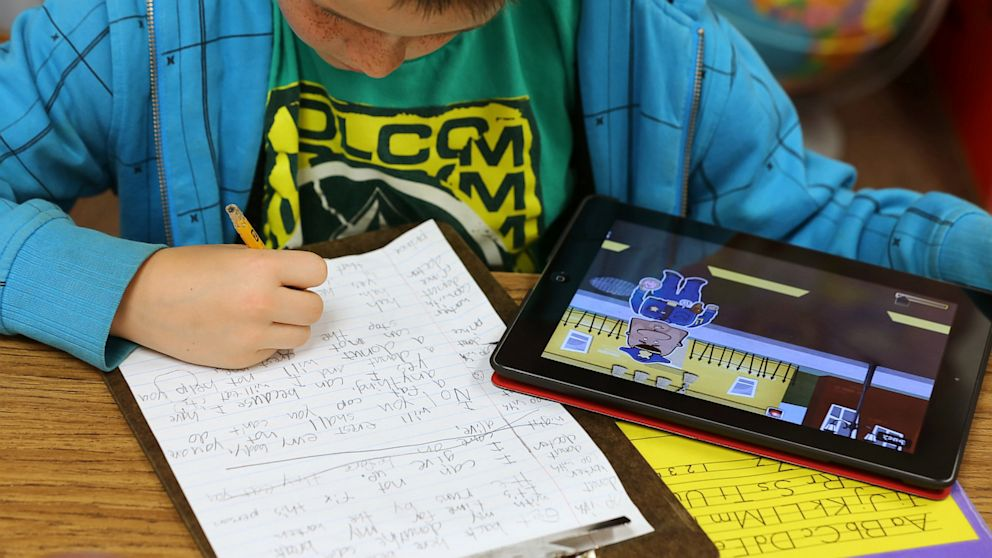 PHOTO: A second grader works on an Apple Inc. iPad as part of his classroom work at Park Lane Elementary school, in the Canyons School District, in Sandy, Utah, U.S. on May 20, 2013.