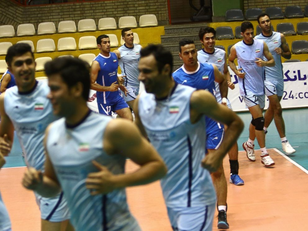PHOTO: Irans volleyball national team players warm up during a training session at Azadi sports hall in Tehran on July 8, 2014.