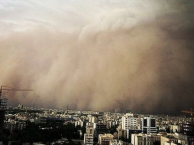 Photos: Massive Sandstorm Swallows Entire City